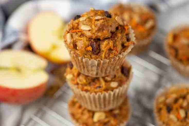 stack of morning glory muffins on a cooling rack