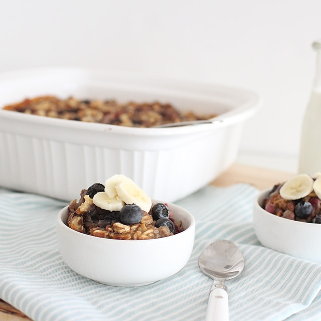 baked berry oatmeal in serving dishes