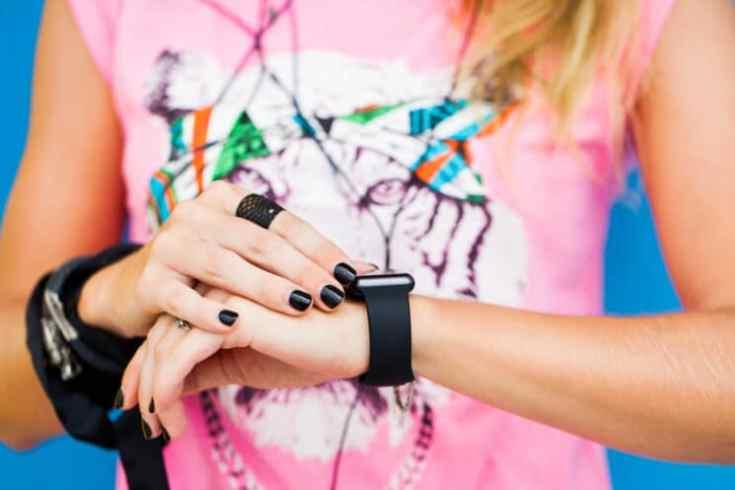 teen wearing a fitness tracker