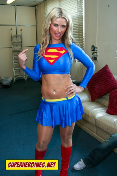 Supergirl in shiny pantyhose daring a thug to take her on