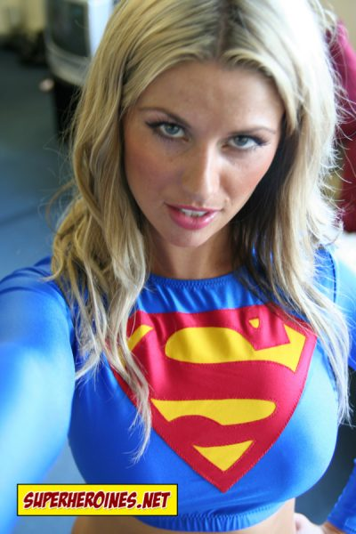 Pretty blonde Supergirl lifting man up by his collar