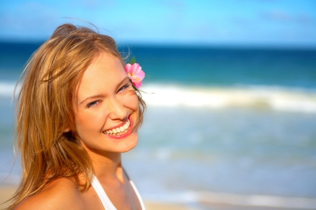Fashion Shot of a Beautiful Young Woman on the Beach