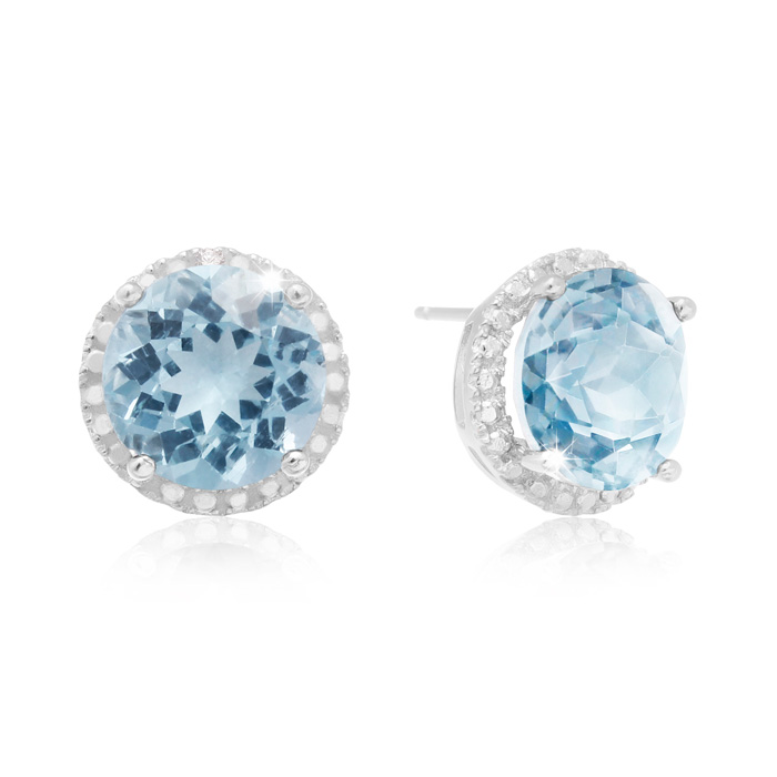 9 Carat Blue Topaz Halo Stud Earrings In Sterling Silver