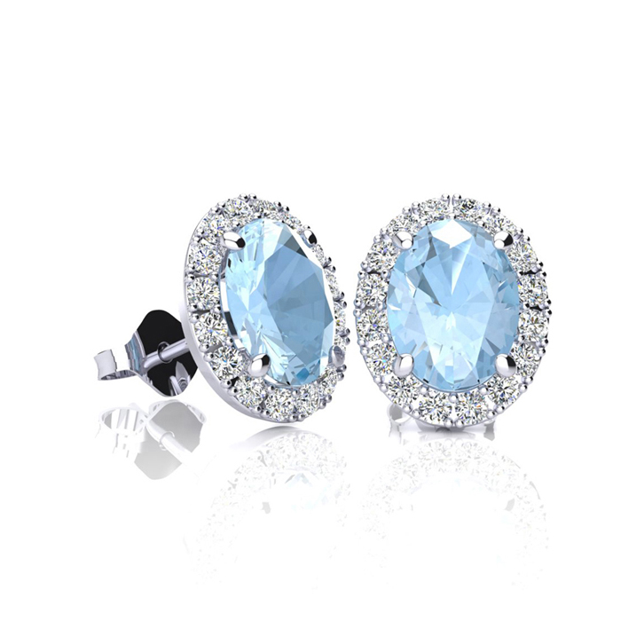 1 Carat Oval Shape Aquamarine and Halo Diamond Stud Earrings In 14 Karat White Gold