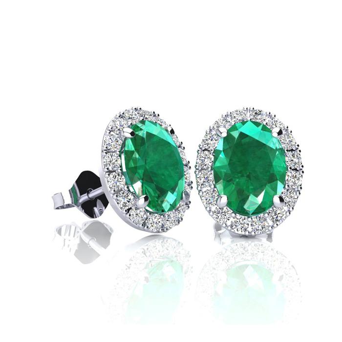 1 Carat Oval Shape Emerald and Halo Diamond Stud Earrings In 10 Karat White Gold