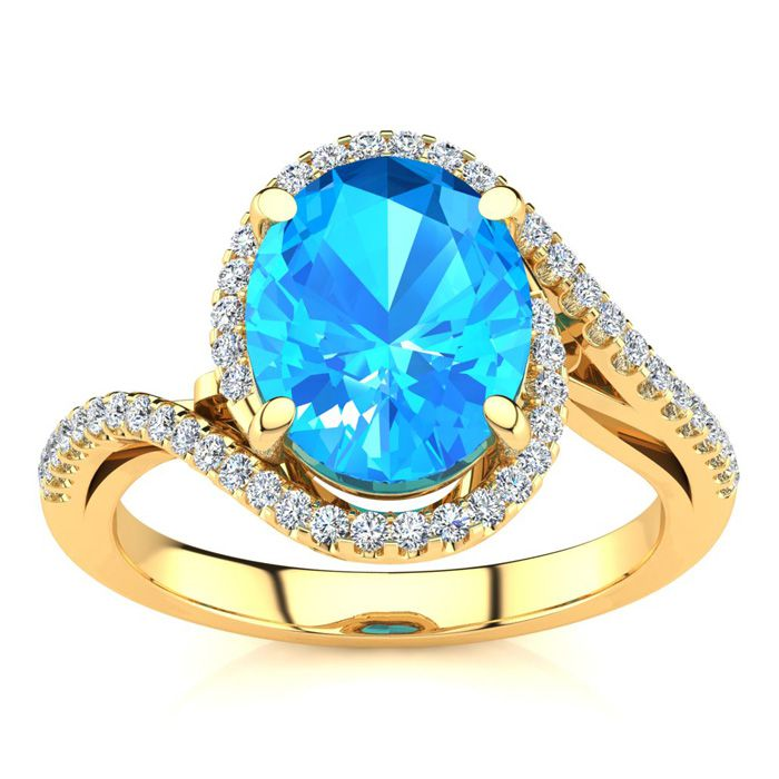 3 1/2 Carat Oval Shape Blue Topaz and Halo Diamond Ring In 14 Karat Yellow Gold