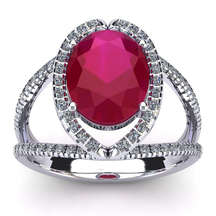3 1/2 Carat Oval Shape Ruby and Halo Diamond Ring In 14 Karat White Gold