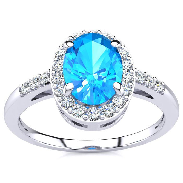 1 Carat Oval Shape Blue Topaz and Halo Diamond Ring In 14K White Gold