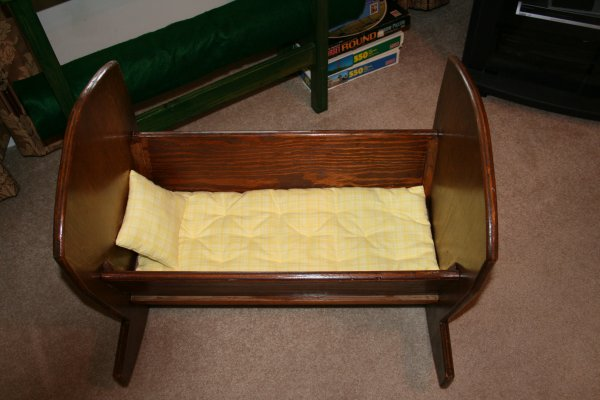 Doll cradle with handmade mattress and pillow