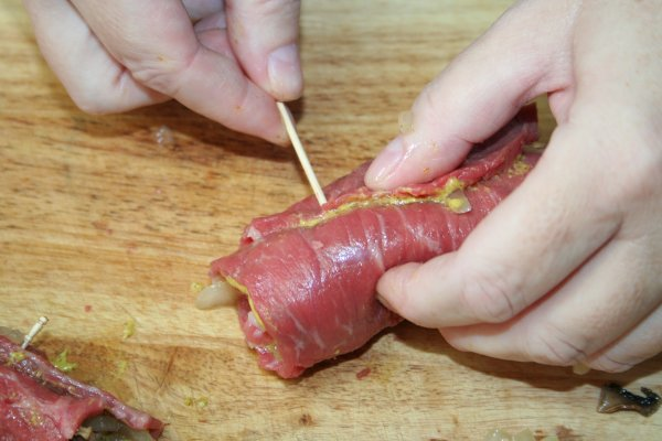 Roll up beef and secure with a toothpick