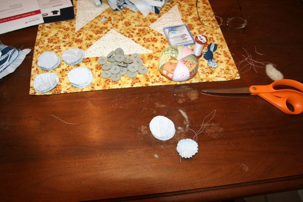 Sew running stitch around edge of circle