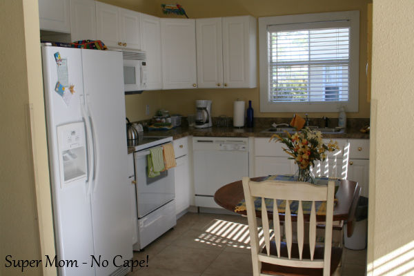 Around the corner from the front door is this cozy little kitchen.