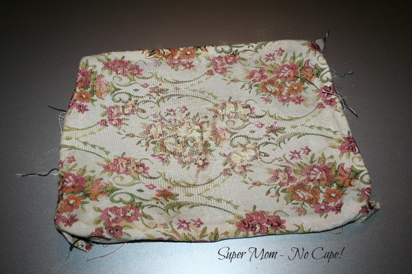 Photo of ratty old footstool cover