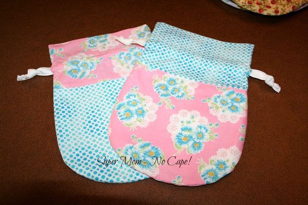 photo of blue and pink drawstring bags