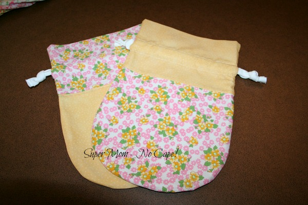Photo of yellow and floral drawstring bags