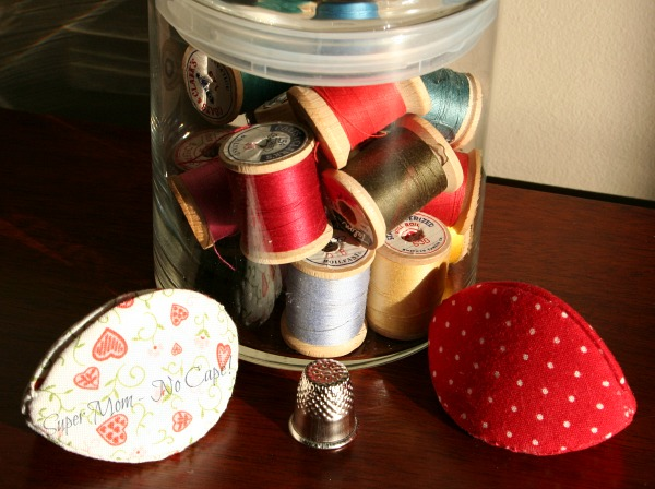 Valentine's Pips, thimble and jar of vintage spools