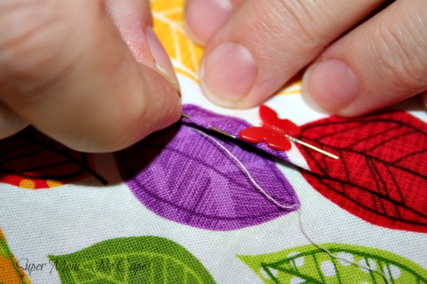 Take a stitch in the pressed edge of the second section.