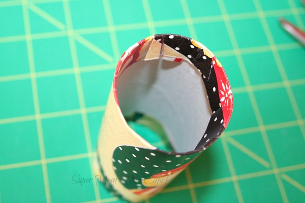 Step 4 - Clip paper and fold down into tube
