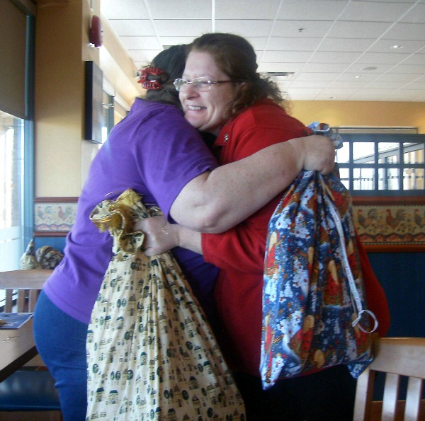 Debbie and I exchanging hugs