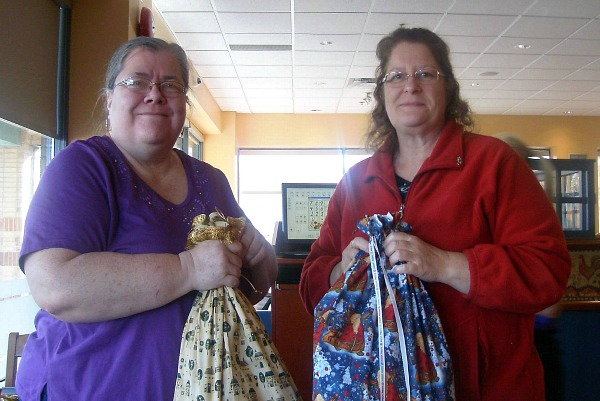 Debbie and I holding the gifts we made for each other