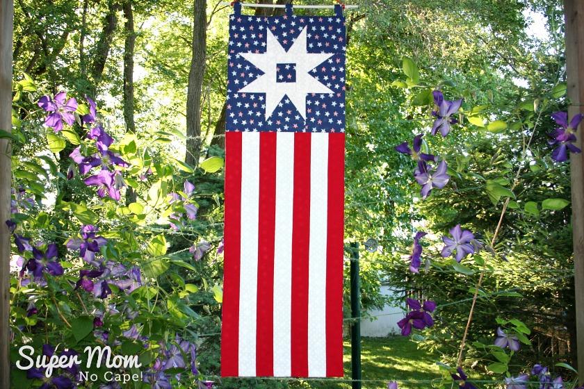 Patriotic Garden Path Banner Hanging in the Backyard