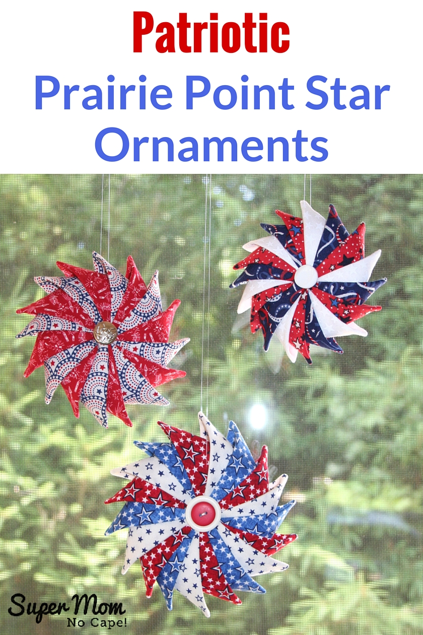 Three Patriotic Prairie Point Star Ornaments hanging in a window