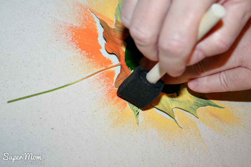 Step 7: Adding a orange paint to the yellow leaf on the Painted Maple Leaf Table Runner
