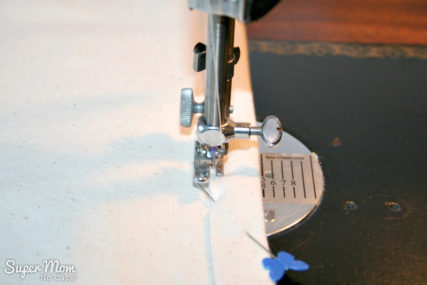 Sewing close to the folded edge to hem the Painted Maple Leaf Table Runner