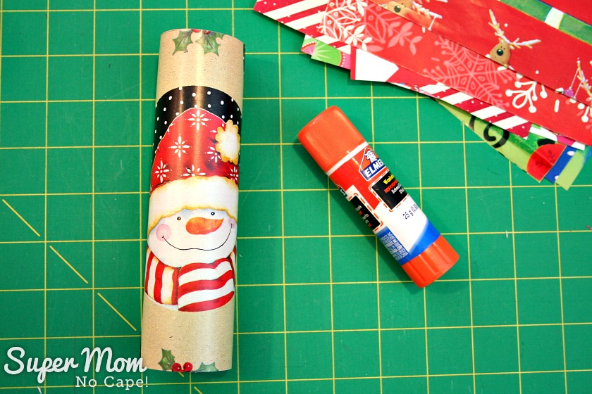 Halloween Treat to Christmas Party Favor - Wrap the paper around the toilet paper tube