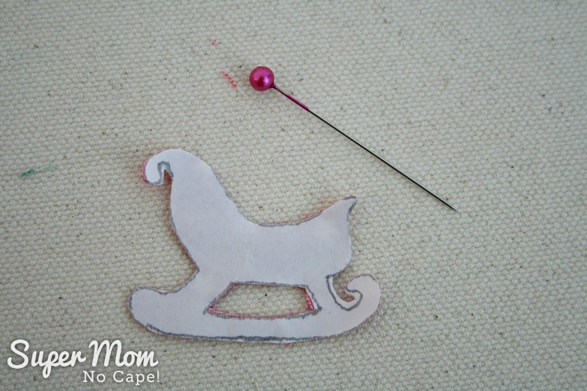 Sawtooth Star with Applique Center Ornament 25. Cut out along the traced lines of the sleigh