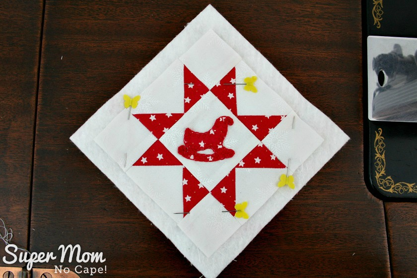 Sawtooth Star with Applique Center Ornament 30. Pin block to batting and backing