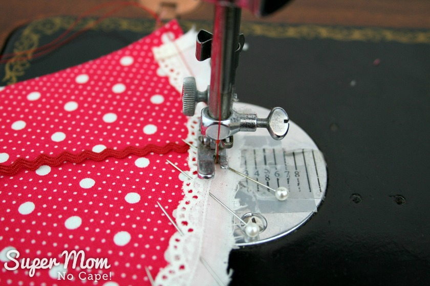 Baste the eyelet trim in place