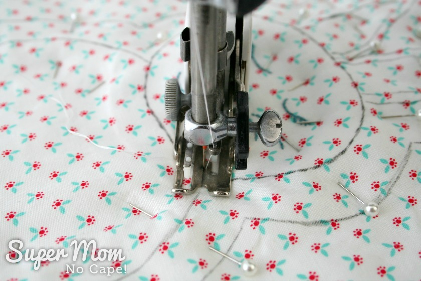 Photo with the needle in the down position and starting to sewing at the neck of the rag quilt bunny