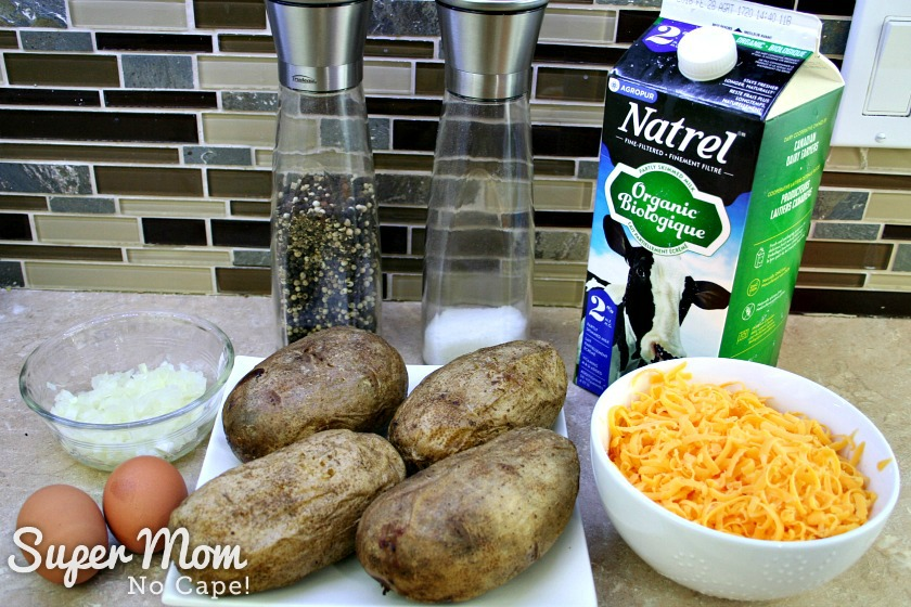 The rest of the ingredients for Twice Baked Potatoes: milk, eggs, onion, grated cheese, salt and pepper