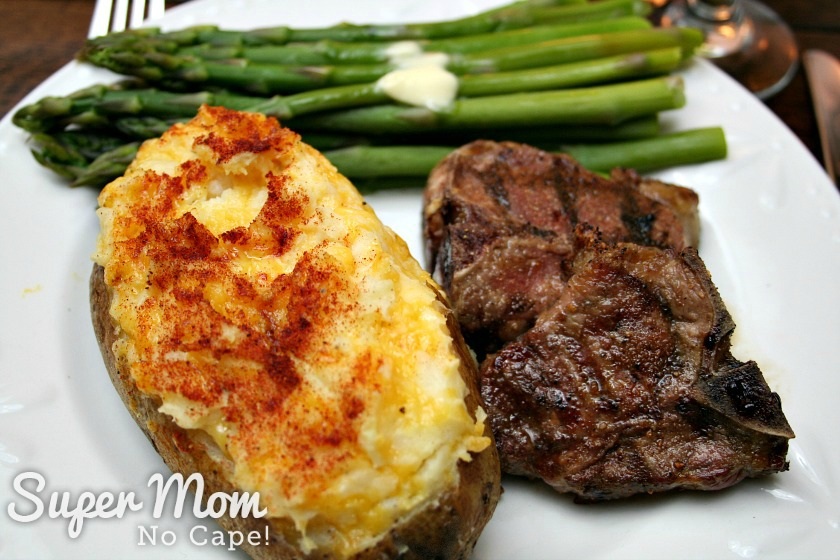 Twice Baked Potato served with grilled lamb chop and asparagus