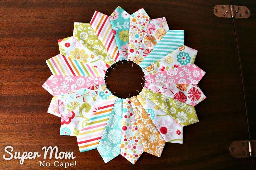 Dresden plate block made from charm squares of Fancy Free by Lori Whitlock