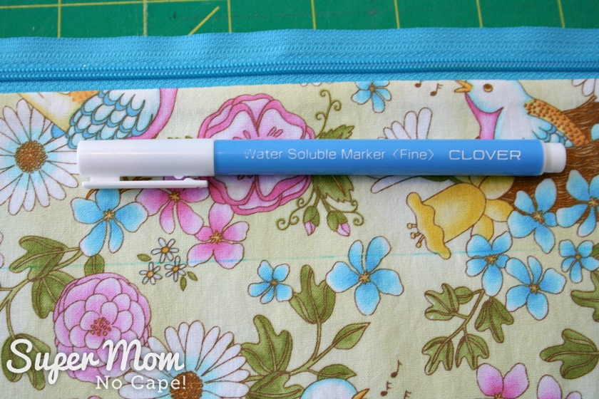 Use a Clover Water Soluble Mark with a fine tip to draw the sewing line