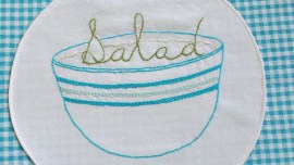 Salad Bowl Embroidery Pattern centered on blue gingham fabric bowl cover