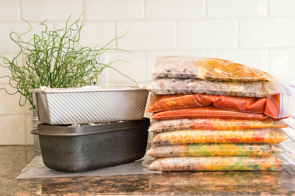 resealable bags stacked on counter top filled with freezer meals from myfreezeasy