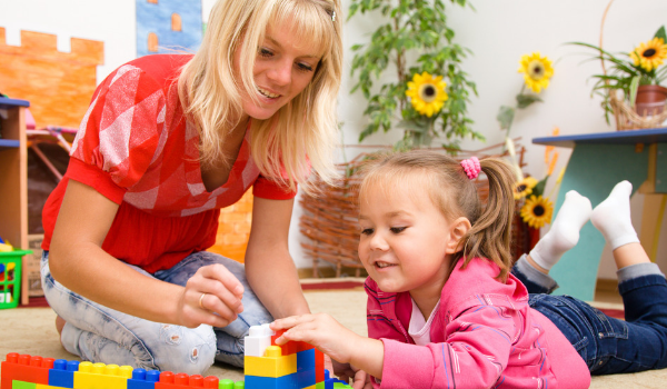 daycare teacher with female child