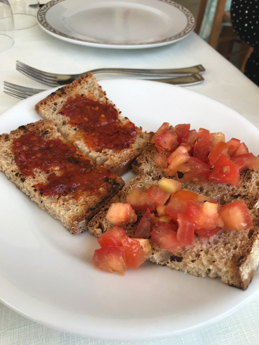 Toasts with tomatoes and wicked N'Duja