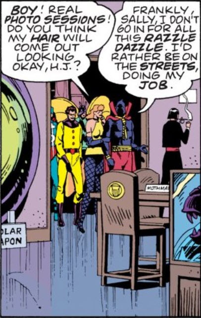 Watchmen Chapter 2, page 5, panel 2. In the foreground are partial views of the heroes' trophies, and in the background they are emerging from a door, having finished with their photo shoot.