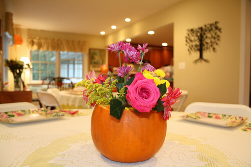 DIY Hollowed Out Pumpkin With Flowers Centerpiece
