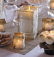 Reception table candles in unique mesh candleholders