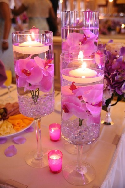 DIY Wedding Table Centerpieces - Cylinders with floating candles and Hot Pink flowers