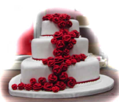 Picture of white wedding cake, three tier, with red roses