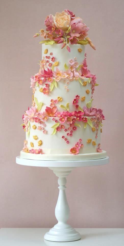 Apple blossoms spring wedding cake.