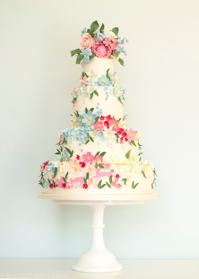 Apple blossoms spring wedding cake.