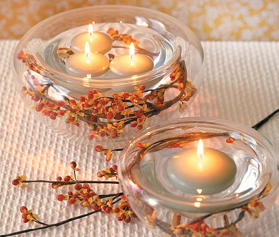 Autumn wedding centerpieces in bowls with floating candles