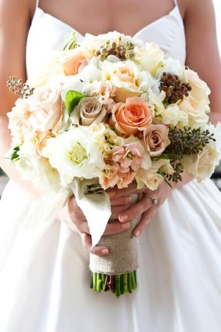 Hand tied bridal bouquet in peach and ivory